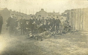 The outdoor firing point about 1911. Note the number of scouts present. The scaffolding shows the houses in the background under the early stages of construction